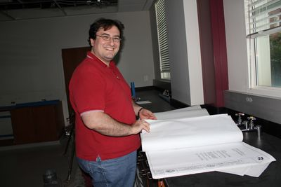 Dr. Bonizzoni pores over the plans for the renovation of the space in Shelby Hall that will become his labs.