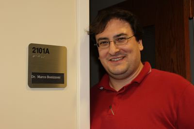 Dr. Marco Bonizzoni in front of his new office.